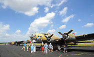 Spectators view a B17G World War II aircraft on display during the Wings of Freedom air show Monday August 29, 2016 at Northeast Philadelphia Airport in Philadelphia, Pennsylvania.  (Photo by William Thomas Cain)