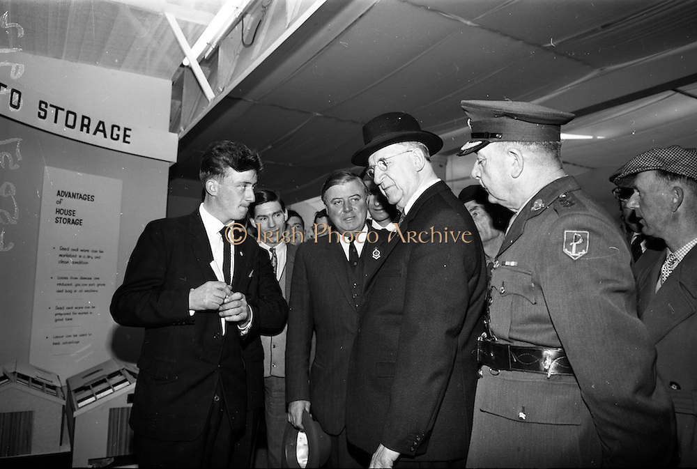 05/05/1965<br /> 05/05/1965<br /> 05 May 1965<br /> President Eamon de Valera visits the RDS Spring Show at Ballsbridge Dublin. Picture shows President de Valera (right) charting with Mr. John Coyle (left) Inspector at the Department of Agriculture, when he visited the Departments stand at the show. Mr. J. Meenan M.A. BL. Chairman of the Executive Committee of the RDS is in the centre.