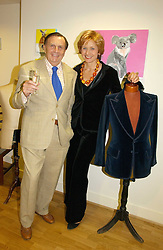 BARRY & LIZZY HUMPHRIES at an exhibition of art by Oscar Humphries entitles 'Post-Nuclear Family' held at Nutters, Lower Ground, 12 Savile Row, London on 8th June 2006.<br />