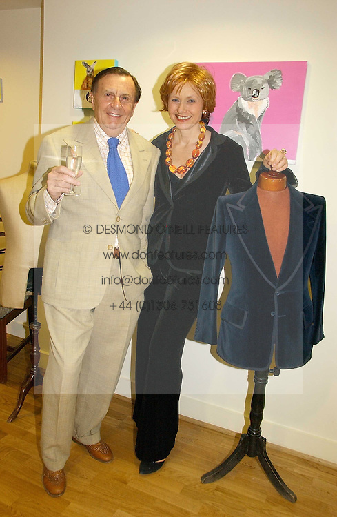 BARRY &amp; LIZZY HUMPHRIES at an exhibition of art by Oscar Humphries entitles 'Post-Nuclear Family' held at Nutters, Lower Ground, 12 Savile Row, London on 8th June 2006.<br />