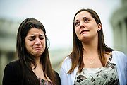 CARLEE SOTO (left) and ERICA LAFFERTY become emotional during a vigil outside the U.S. Capitol on Tuesday to remember those tragically murdered and demand congressional action on gun legislation. Erica Lafferty's mother was the principal at Sandy Hook and Carlee's sister was a teacher there. Families and friends of those killed and injured six years ago at Virginia Tech stand with families of the victims and survivors of the Tucson, Aurora, and Newtown massacres outside the U.S. Capitol.