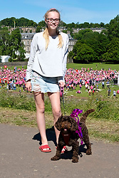Pictured: Millie Davies (14) and Indie the dog were there to support Millie's mother and sisters who were taking part in the Race For Life<br /> <br /> Two thousand people gathered in Holyrood Park Edinburgh for Cancer Reasearch'e Race for Life . The runmners, the majority of whom were women, took part in 5K and 10K events. ,<br /> <br /> Ger Harley | EEm 24 June 2018