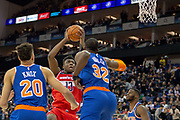 Washington Wizards Thomas Bryant (13), New York Knicks Kevin Knox (20) and New York Knicks Noah Vonieh (32) during the NBA London Game match between Washington Wizards and New York Knicks at the O2 Arena, London, United Kingdom on 17 January 2019.