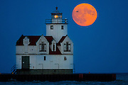 The Kewaunee, Wisconsin lighthouse as a super moon rises over Lake Michigan.  Photo by Mike Roemer