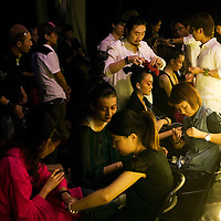 BEIJING, MAY -7, 2012 : models get their make-up and hair done  before Guo Pei's fashion show. ..Guo Pei , 45, is China's answer to haute couture. When she started out 15 years ago, there was no fashion in China .  Since then though  about everything in China has changed. Many more people are able to afford luxury products, and Chinese women, at least those who can afford it, follow international fashion trends. What makes Guo Pei different is what she puts on a runway. She employs 300 people in a workroom two hours from Beijing. She had to train them, but it?s also true that her creative freedom is tethered to relatively cheap labor. One dress alone, made entirely of golden panels, took 50,000 hours to embroider.
