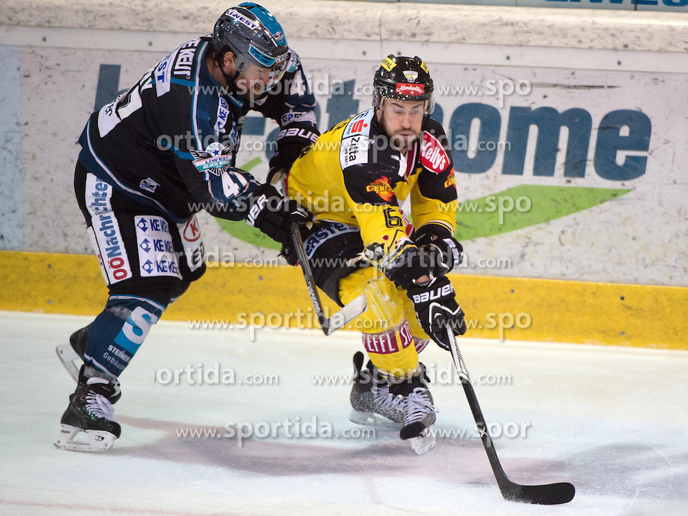 31.03.2015, Keine Sorgen Eisarena, Linz, AUT, EBEL, EHC Black Wings Linz vs UPC Vienna Capitals, Halbfinale, 5. Spiel, im Bild v.l. Curtis Murphy (EHC Liwest Black Wings Linz), Rafael Rotter (UPC Vienna Capitals) // during the Erste Bank Icehockey League 5th semifinal match between EHC Black Wings Linz and UPC Vienna Capitals at the Keine Sorgen Eisarena in Linz, Austria on 2015/03/31. EXPA Pictures © 2015, PhotoCredit: EXPA/ Reinhard Eisenbauer