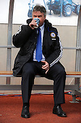 Chelsea manager Guus Hiddink enjoys a coffee during the FA Cup Sponsored by E.ON 6th round match between Coventry City and Chelsea at the Ricoh Arena on March 7, 2009 in Coventry, England.