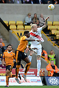 Simon Makienok wins a header against Kortney Hause during the Sky Bet Championship match between Wolverhampton Wanderers and Charlton Athletic at Molineux, Wolverhampton, England on 29 August 2015. Photo by Alan Franklin.