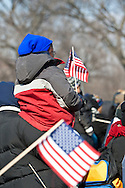 A small child rides on her father's shoulders at the historic inauguration of President Barrack Obama.