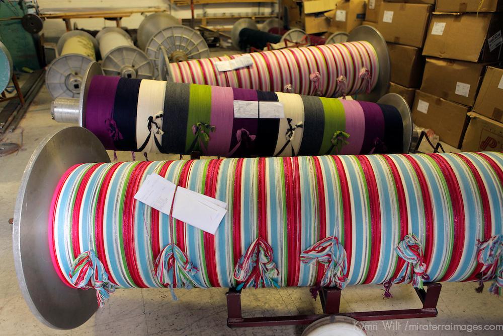 Europe, Ireland, Avoca. Avoca Handweavers Mill, County Wicklow. Bolts of wool thread.