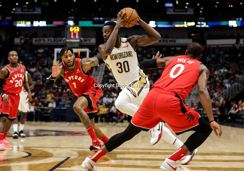 Oct 11, 2018; New Orleans, LA, USA; New Orleans Pelicans forward Julius Randle (30) drives past Toronto Raptors center Eric Moreland (1) and forward CJ Miles (0) during the first half at the Smoothie King Center. Mandatory Credit: Derick E. Hingle-USA TODAY Sports