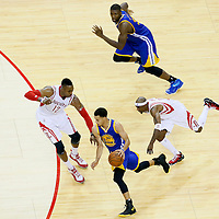 23 May 2015: Golden State Warriors guard Stephen Curry (30) drives past Houston Rockets guard Jason Terry (31) on a screen set by Golden State Warriors center Festus Ezeli (31) and faces Houston Rockets center Dwight Howard (12) during the Golden State Warriors 115-80 victory over the Houston Rockets, in game 3 of the Western Conference finals, at the Toyota Center, Houston, Texas, USA.