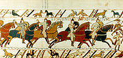 Bayeux Tapestry 1067. Battle of Hastings, 14 October 1066.  Norman cavalry charging. William I, the Conqueror, defeated Harold II, last Anglo-Saxon king of England.  Warfare Armour Shield Spear Horse Archer  Textile Linen