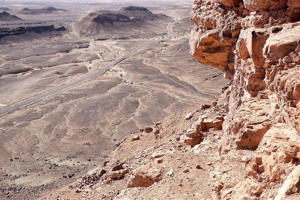 Stony desert landscapes with road and acacia trees, M'hamid, Sahara desert, Morocco.