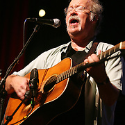 BREVARD, NC - SEPTEMBER 12 :  Dudley Connell of The Seldom Scene performs in the Mountain Song Festival at The Brevard Music Center on September 12, 2009,  in Brevard, North Carolina, USA. (Photo by Logan Mock-Bunting/Getty Images)