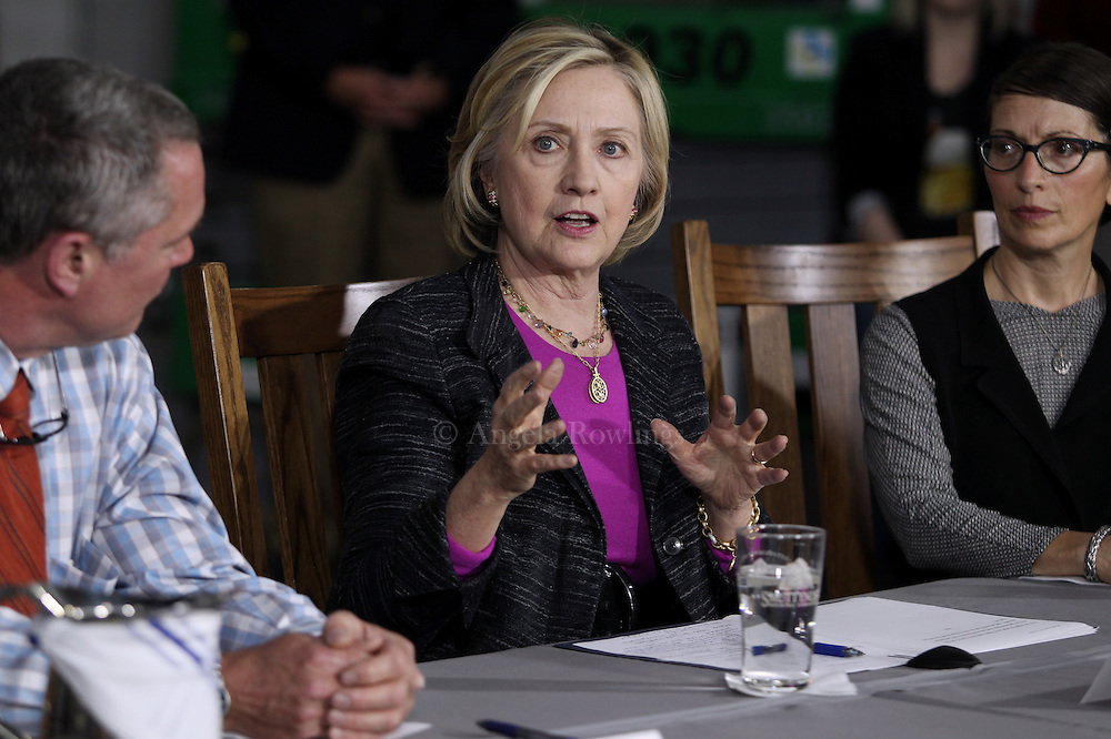 (Hampton, NH - 5/22/15) Former Secretary of State and presidential candidate Hillary Clinton speaks during a roundtable discussion with small business owners at Smuttynose Brewery, Friday, May 22, 2015. Smuttynose Brewing Company Co-owners Peter Egelston, left, and Joanne Francis, right, listen. Staff photo by Angela Rowlings.