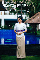 A staff member near the outdoor pool at Holiday Inn Resort Benoa in Bali, Indonesia.