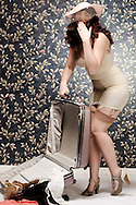 open suitcase with sexy model in a classic Pin up set