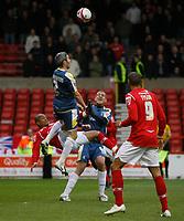 Photo: Richard Lane/Richard Lane Photography. Nottingham Forest v Cardiff City. Coca Cola Championship. 24/10/2008. Rob Earnshaw (lower) tries an overhead kick as Kevin McNaughton (L) heads clear
