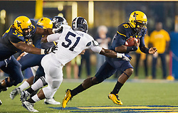 Sep 5, 2015; Morgantown, WV, USA; West Virginia Mountaineers quarterback William Crest Jr. attempts to run past Georgia Southern Eagles defensive lineman Jamal Johnson during the second quarter at Milan Puskar Stadium.  Mandatory Credit: Ben Queen-USA TODAY Sports