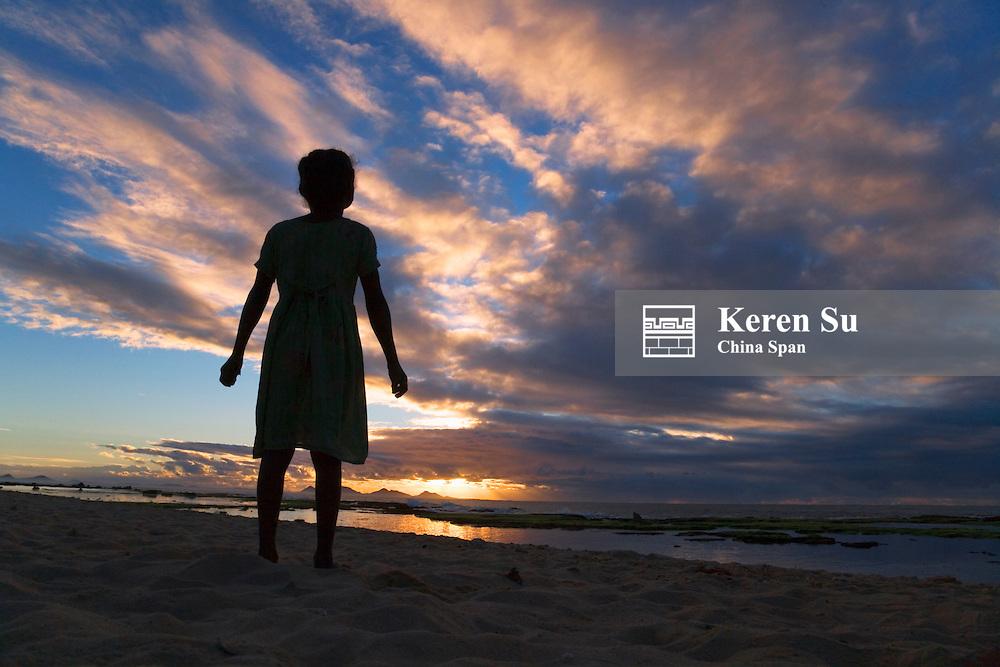 Child on the beach at sunrise,  Fort Dauphin, Madagascar