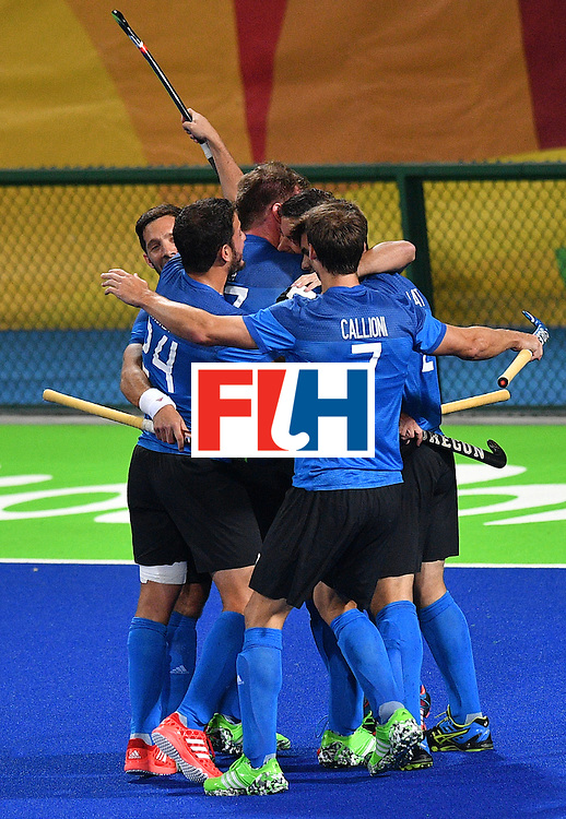 Argentina's players celebrate scoring during the mens's field hockey Ireland vs Argentina match of the Rio 2016 Olympics Games at the Olympic Hockey Centre in Rio de Janeiro on August, 12 2016. / AFP / Carl DE SOUZA        (Photo credit should read CARL DE SOUZA/AFP/Getty Images)