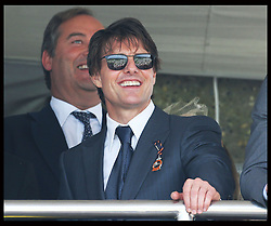 Image licensed to i-Images Picture Agency. 31/07/2014. Goodwood. United Kingdom. Tom Cruise watches the horse racing at Ladies Day at Glorious Goodwood.  Picture by Stephen Lock / i-Images