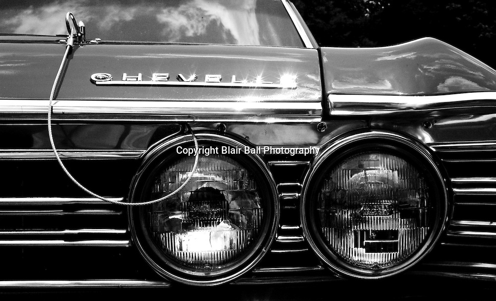 Old Chevy Chevelle headlines in black and white, taken at a junkyard in Northwestern, TN