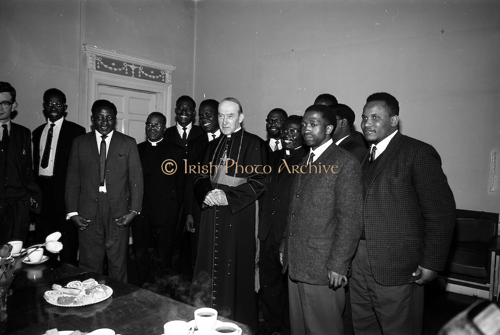 """06/05/1965<br /> 05/06/1965<br /> 06 May 1965<br /> African Students on a visit to Dublin meet Archbishop McQuaid. A group of African students of Catholic Sociology from Claver House, London, on an educational holiday to Ireland. The group stayed with Irish families under the auspices of """"Le Cheile"""" a group that promoted friendship and exchange of culture between Irish and overseas people. the students were entertained by His Grace, Most Rev. Dr. McQuaid, Archbishop of Dublin to a visit to the Dublin Institute of Catholic Sociology. Photo Shows Archbishop McQuaid with the visitors."""