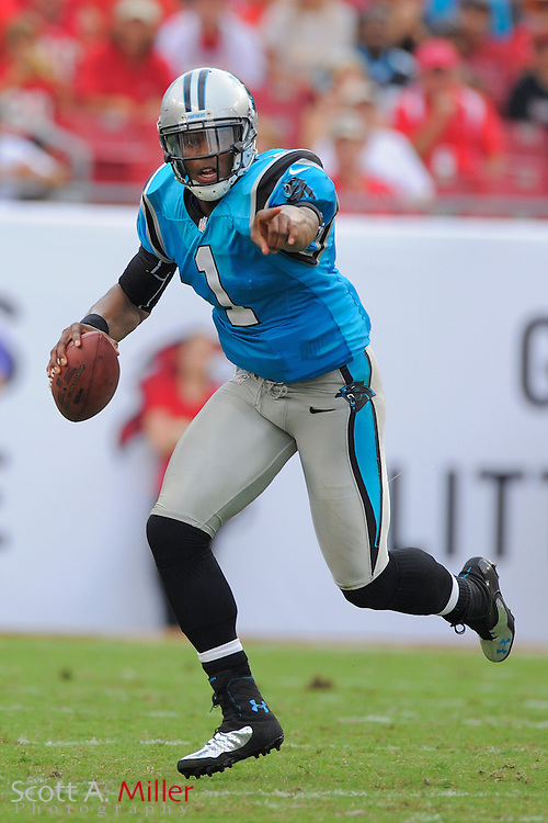 Carolina Panthers quarterback Cam Newton (1) points for a block as he runs upfield during the Panthers 16-10 loss to the Tampa Bay Buccaneers at Raymond James Stadium  on September 9, 2012 in Tampa, Florida. ..©2012 Scott A. Miller...