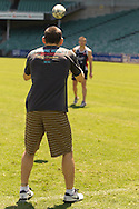 SYDNEY, AUSTRALIA, FEBRUARY 24, 2011: Jon Fitch (near) receives a pass from Shaun Kenny-Dowall of Sydney Roosters during a media event at Sydney Football Stadium in Sydney, Australia on February 24, 2011