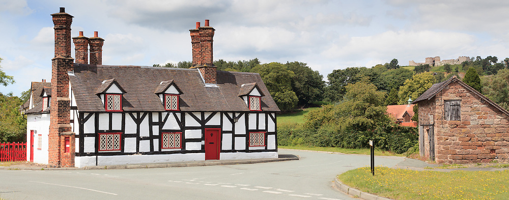 A pretty half-timbered Cheshire cottage in the village of Beeston, overlooked by Beeston Castle.