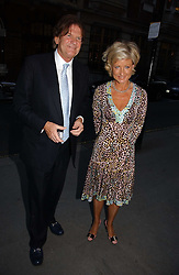 JOHN MADEJSKI and JANIE MACLELLAN at an exhibition of photographs by Lord Snowdon held at the Chris Beetles Gallery, Ryder Street, London on 18th September 2006.<br />