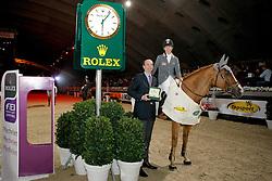Sato Eiken (JPN) - Cartoon Z receiving the Rolex watch from Mr.     <br /> Winner Rolex Fei World Cup Qualifier<br /> CSI-W Mechelen 2009<br /> Photo © Dirk Caremans