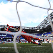 New York Red Bulls Dax McCarty (obscured) beats a diving Philadelphia Union Goalkeeper Zac MacMath for the Red Bulls first goal during their 2-1 victory during the New York Red Bulls V Philadelphia Union, Major League Soccer regular season match at Red Bull Arena, Harrison, New Jersey. USA. 30th March 2013. Photo Tim Clayton