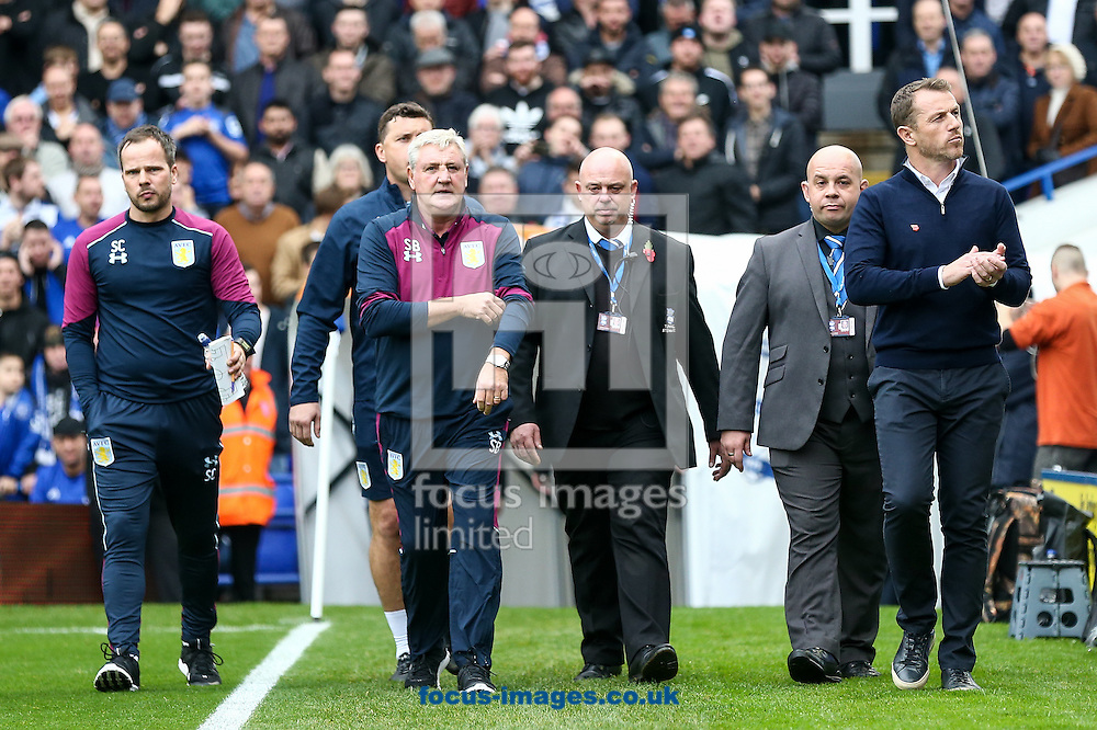 Birmingham City manager Gary Rowett (right) and Aston Villa manager Steve Bruce (2nd left) take to the pitch together during the Sky Bet Championship match at St Andrews, Birmingham<br /> Picture by Andy Kearns/Focus Images Ltd 0781 864 4264<br /> 30/10/2016