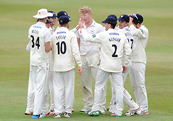 Michael Klinger of Gloucestershire celebrates with team mates catching Adam Rossington of Northamptonshire bowled by Liam Norwell of Gloucestershire - Photo mandatory by-line: Dougie Allward/JMP - Mobile: 07966 386802 - 08/07/2015 - SPORT - Cricket - Cheltenham - Cheltenham College - LV=County Championship 2