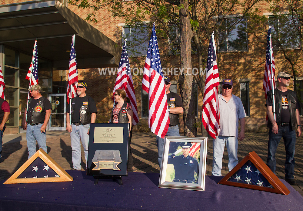 Goshen, New York - Members of the Patriot Guard hold American flags during the Orange County Law Enforcement Officer Memorial Service on May 8, 2015, at the entrance of the Orange County Courthouse. The memorial service honors the memory of the members of the Orange County law enforcement community that died in the line of duty. The service also pays tribute the families and loved ones left behind for their courage, dignity and perseverance.