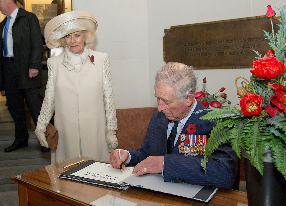 Prince Charles, Prince of Wales and Camilla, Duchess of Cornwall signing the visitors book after a wreath laying ceremony at the National War Memorial, Wellington, New Zealand, Wednesday, November 04, 2015. Credit:SNPA / NZ Herald, Marl Mitchell **POOL**