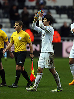 Wednesday 09 February 2013..Pictured: Ki Sung Yueng of Swansea thanks home supporters..Re: Barclay's Premier League, Swansea City FC v Queen's Park Rangers at the Liberty Stadium, south Wales.