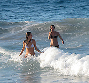 **EXCLUSIVE**Alessandra Ambrosio.Brazilian Victoria Secret Model Alessandra Ambrosio brave the big waves and go swimming in the sea.St. Barth, Caribbean.Friday, December 31, 2010.Photo By CelebrityVibe.com.To license this image please call (212) 410 5354; or Email: CelebrityVibe@gmail.com ; website: www.CelebrityVibe.com