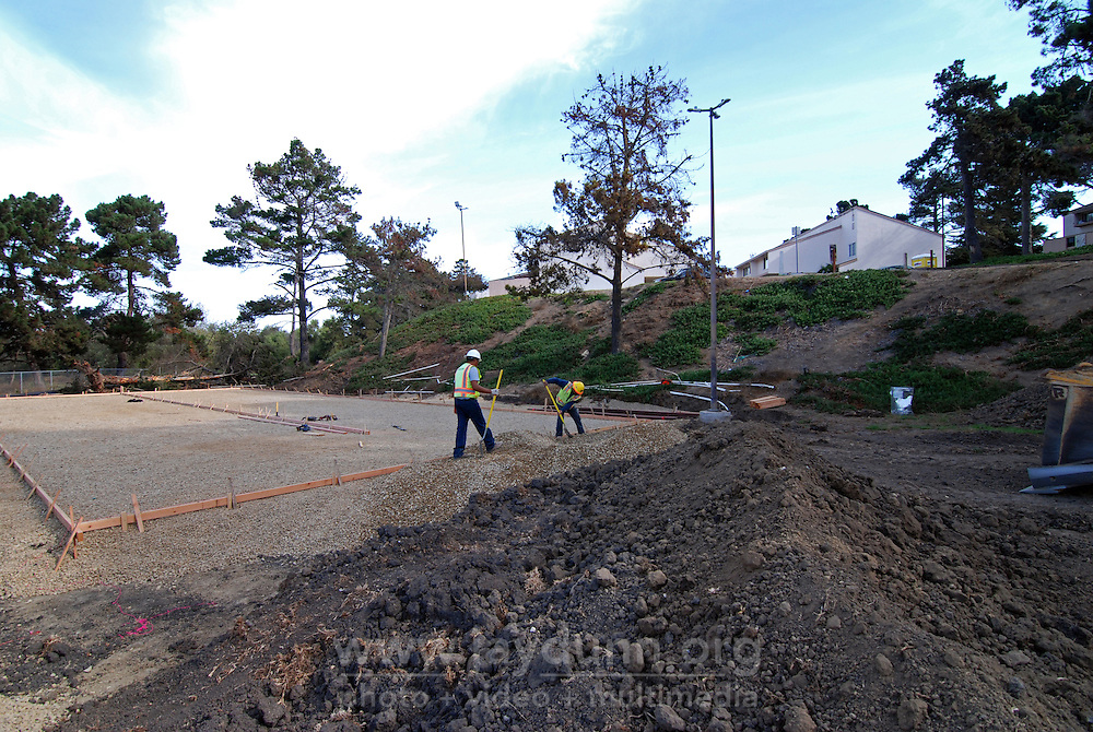 Crew members from San Benito Supply work on framing the basketball court at the Acosta Plaza Recreation Area project in east Salinas, CA on October 23rd, 2015. The entire project was designed to drain water easily  as it is subject to potential seasonal flooding.