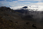 Sunrise at the top of Haleakala, Maui's giant dormant volcano. At exactly 8 a.m., the clouds disappear within seconds, and reveal a mile-wide panoramic of the giant crater.