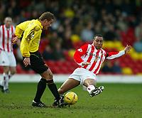 Photo: Scott Heavey.<br />Watford v Sunderland. Nationwide Division One. 07/02/2004.<br />Jeff Whitley dives in on Neal Ardley