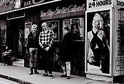 Teenage boys standing outside Raymond Revue Bar, Soho, London, UK, 1983