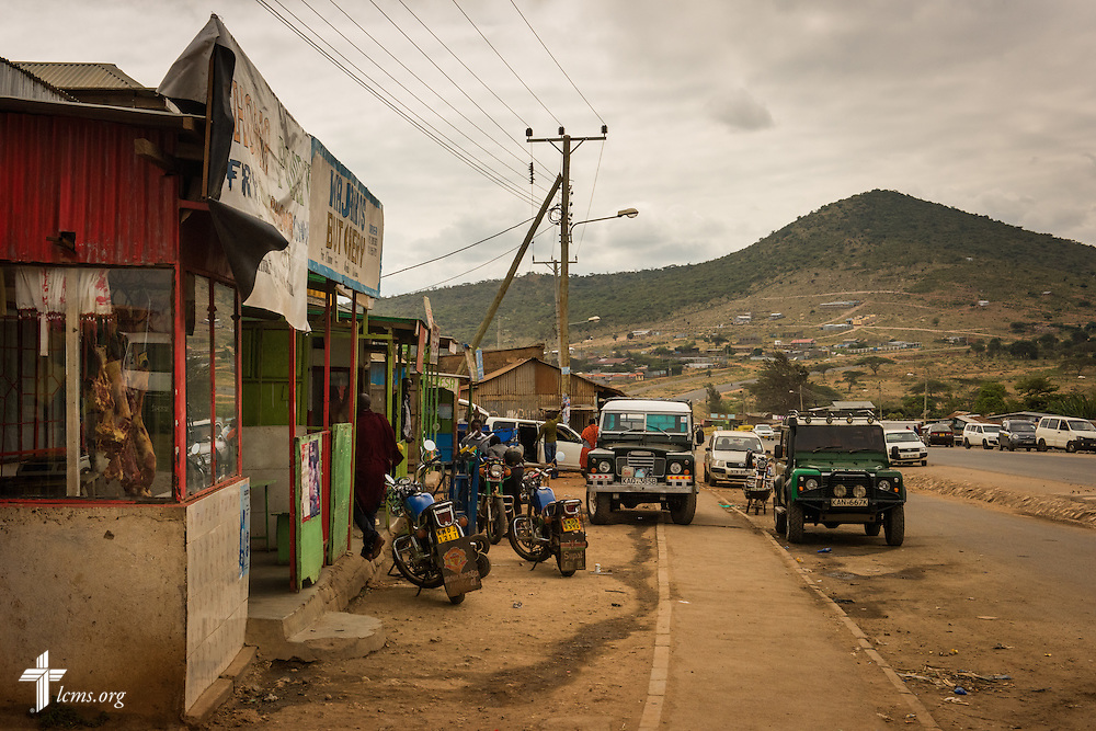 A butcher flanks a street in the closest town to the Lenkishon ELCK (Evangelical Lutheran Church in Kenya) Project 24 construction site on Saturday, June 25, 2016, near Lenkishon, Kenya.  LCMS Communications/Erik M. Lunsford