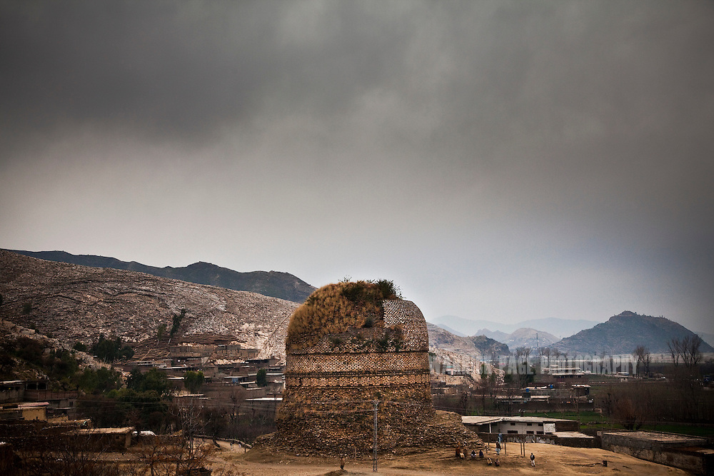 The Shingardar Stupa is seen amidst a small rural village in the Swat Valley, on February 11, 2011, in Gumbatuna, Pakistan. The Kingdom of Gandhara lasted from early 1st millennium BC to the 11th century AD, and was located in northern Pakistan and eastern Afghanistan. (Photo by Warrick Page)