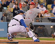 Reds Jay Bruce #32 is tagged out at the plate by Los Angeles Dodgers catcher Yasmani Grandal #9 when he tried to stretch a triple into a home run in the 4th inning. Reds Brandon Phillips was driven in on the play.  The Los Angeles Dodgers played the Cincinnati Reds at Dodger Stadium in Los Angeles , CA.  May 25, 2016. (Photo by John McCoy/Southern California News Group