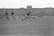 Cork player bounces slitor on his hurl while running during at the All Ireland Senior Hurling Final, Cork v Kilkenny in Croke Park on the 3rd September 1972. Kilkenny 3-24, Cork 5-11.