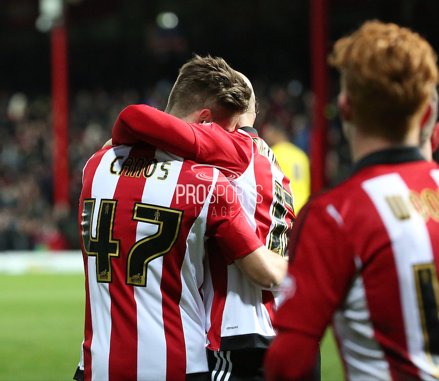 Brentford midfielder Sergi Canos celebrating scoring with Brentford midfielder Alan McCormack during the Sky Bet Championship match between Brentford and Nottingham Forest at Griffin Park, London, England on 21 November 2015. Photo by Matthew Redman.